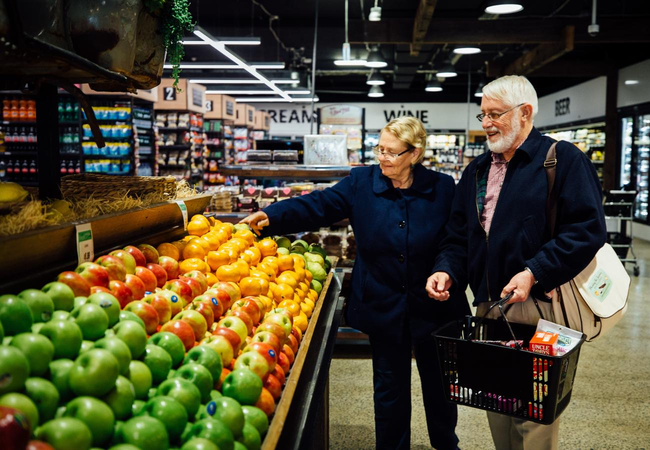 Woman and man choosing fruit at a supermarket